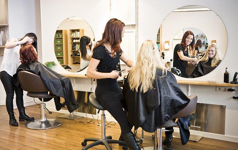 hair stylists cutting two women's hair in a memphis, tn hair salon
